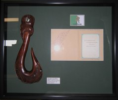 Maori hook carving with document